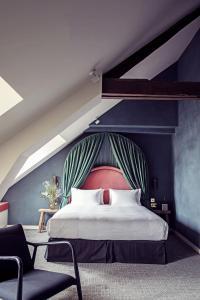 Un ou plusieurs lits dans un hébergement de l'établissement Hotel des Grands Boulevards