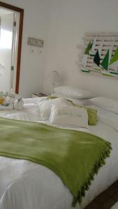 A bed or beds in a room at Pousada Casa do Bicho Preguiça