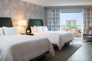 A bed or beds in a room at The Vinoy® Renaissance St. Petersburg Resort & Golf Club