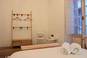 A bed or beds in a room at Slow City Hostel Pontevedra