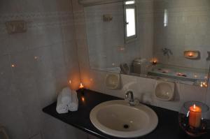 A bathroom at Sun And Sea Apartments