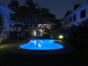 The swimming pool at or near Mango Lagoon Sunbird Retreat