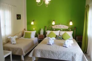 Un ou plusieurs lits dans un hébergement de l'établissement Evizorzia Villas