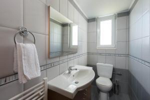 A bathroom at Family apartment near the sea