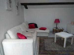 A seating area at Les Toits du Prado