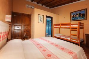 A bunk bed or bunk beds in a room at Santa Maria Resort