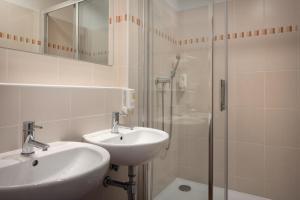 Ванная комната в Congress & Wellness Hotel Olsanka