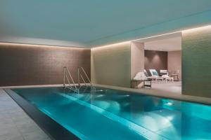 The swimming pool at or near Adina Apartment Hotel Leipzig