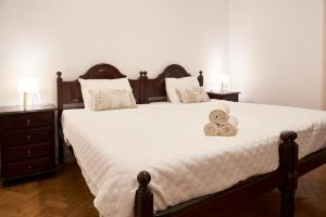 A bed or beds in a room at Lovely home in the center