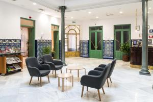 Lobbyn eller receptionsområdet på Hotel Inglaterra