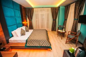 A bed or beds in a room at Borapark Otel