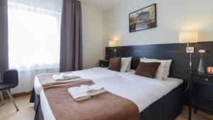 A bed or beds in a room at Best Western Hotel City Gavle