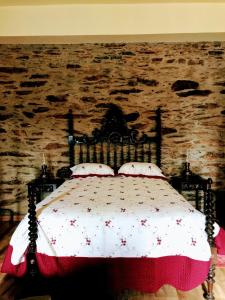 Uma cama ou camas num quarto em Casa da Escola Antiga