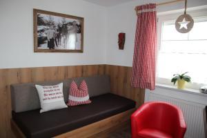 Ein Sitzbereich in der Unterkunft Apart Silvana