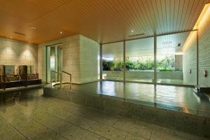 The swimming pool at or near Mitsui Garden Hotel Kashiwa-No-Ha