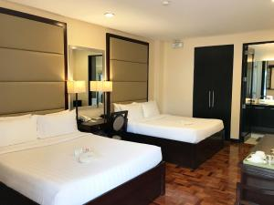 A bed or beds in a room at Jinjiang Inn Boracay Station 1