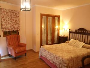 A bed or beds in a room at Hotel El Curro