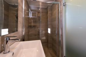 A bathroom at Lindian Jewel Hotel and Villas