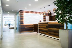 The lobby or reception area at Armon Suites Hotel