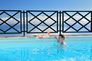 The swimming pool at or near Corral de Payo Casita Blanca