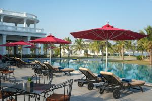 The swimming pool at or near Paradise Suites Hotel
