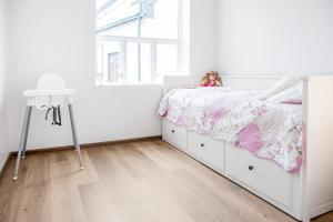 A bed or beds in a room at Aalesund Apartments - City Center