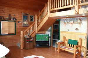 A television and/or entertainment center at The Gingerbread Cabin