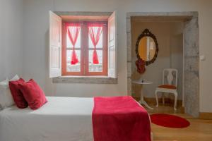 Een bed of bedden in een kamer bij The Poets Inn