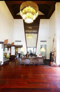 The lobby or reception area at De Naga Hotel, Chiang Mai