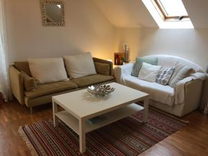 A seating area at Apartment thermale luxeuil