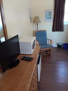 A television and/or entertainment center at Mountain View Motel