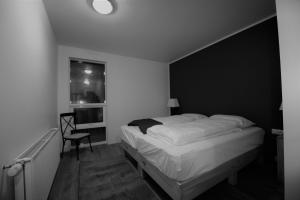 A bed or beds in a room at Kerlingarfjöll Mountain Resort