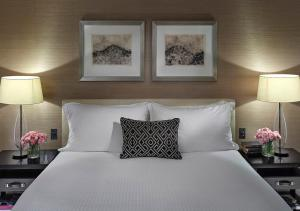 A bed or beds in a room at Crown Towers Melbourne