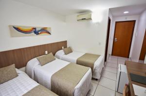 Cama ou camas em um quarto em Villa Park Hotel