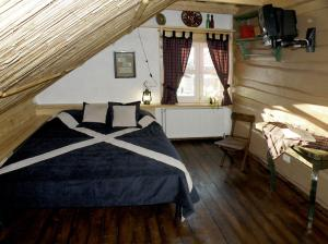 A bed or beds in a room at Salamandra Village