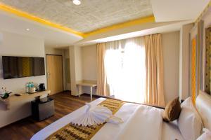 Een bed of bedden in een kamer bij Bodhi Boutique Hotel
