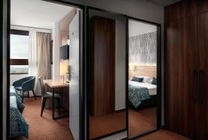 Кровать или кровати в номере Congress & Wellness Hotel Olsanka