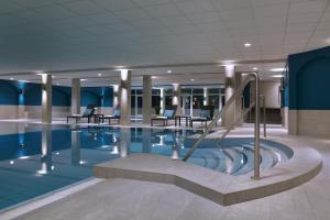 The swimming pool at or near Van der Valk Hotel Gilze-Tilburg