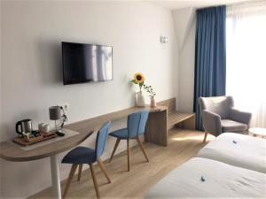 Télévision ou salle de divertissement dans l'établissement Hotel Bosch En Zee