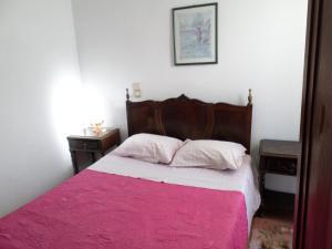 A bed or beds in a room at Rustico & Singelo - Hotelaria e Restauração, Lda