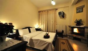 Ένα ή περισσότερα κρεβάτια σε δωμάτιο στο Το Μπαλκόνι της Λίμνης Πλαστήρα