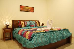 A bed or beds in a room at Sedana Jaya