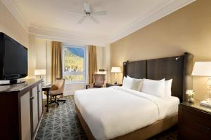A bed or beds in a room at Fairmont Banff Springs