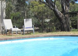 The swimming pool at or near Golden Heritage Accommodation