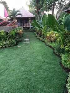 A garden outside The Jingga Villas