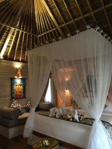 A bed or beds in a room at The Jingga Villas