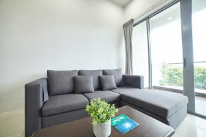 A seating area at State Residences The Loft @ Imago Mall