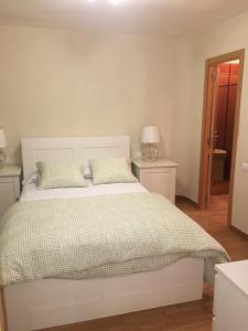 Cama o camas de una habitación en APARTAMENTO CENTRICO PARKING - WIFi