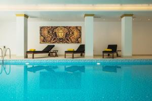 The swimming pool at or near Theoxenia Residence