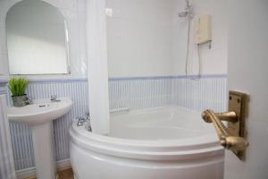 A bathroom at Apex - Sea Front House Cleethorpes